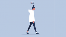 Woman in white top walks beneath low battery icon