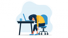 remote work fatigue - employee resting head on desk